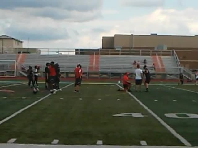 DeKalb runs a passing drill during its first practice.
