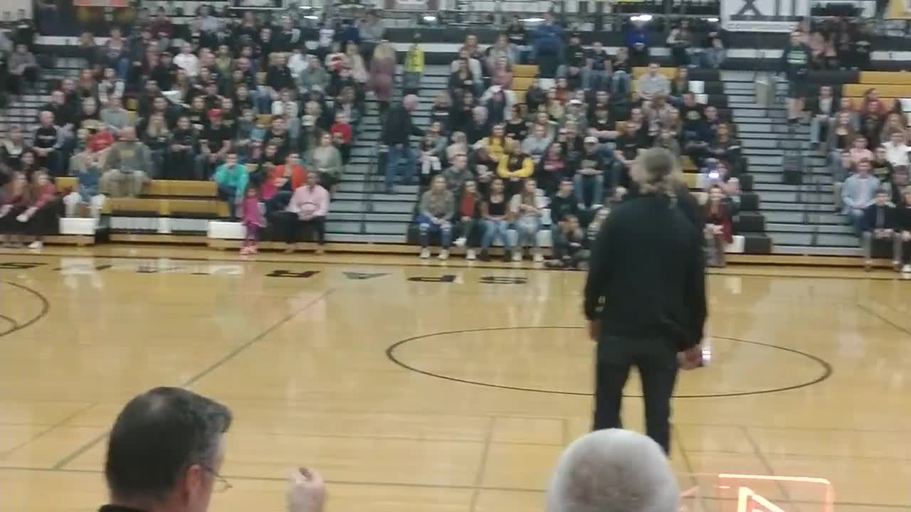 Baggett, Perry, Carlsen miss half court shots for contest.