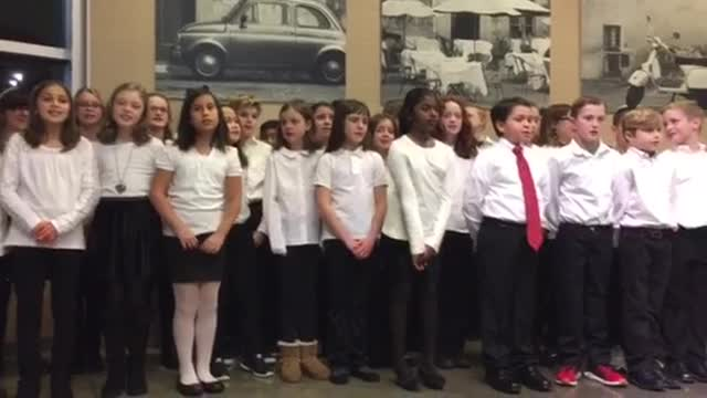 Elmhurst Emerson Elementary School fourth and fifth graders sing Christmas carols at Mariano's with teacher Joel Miller.
