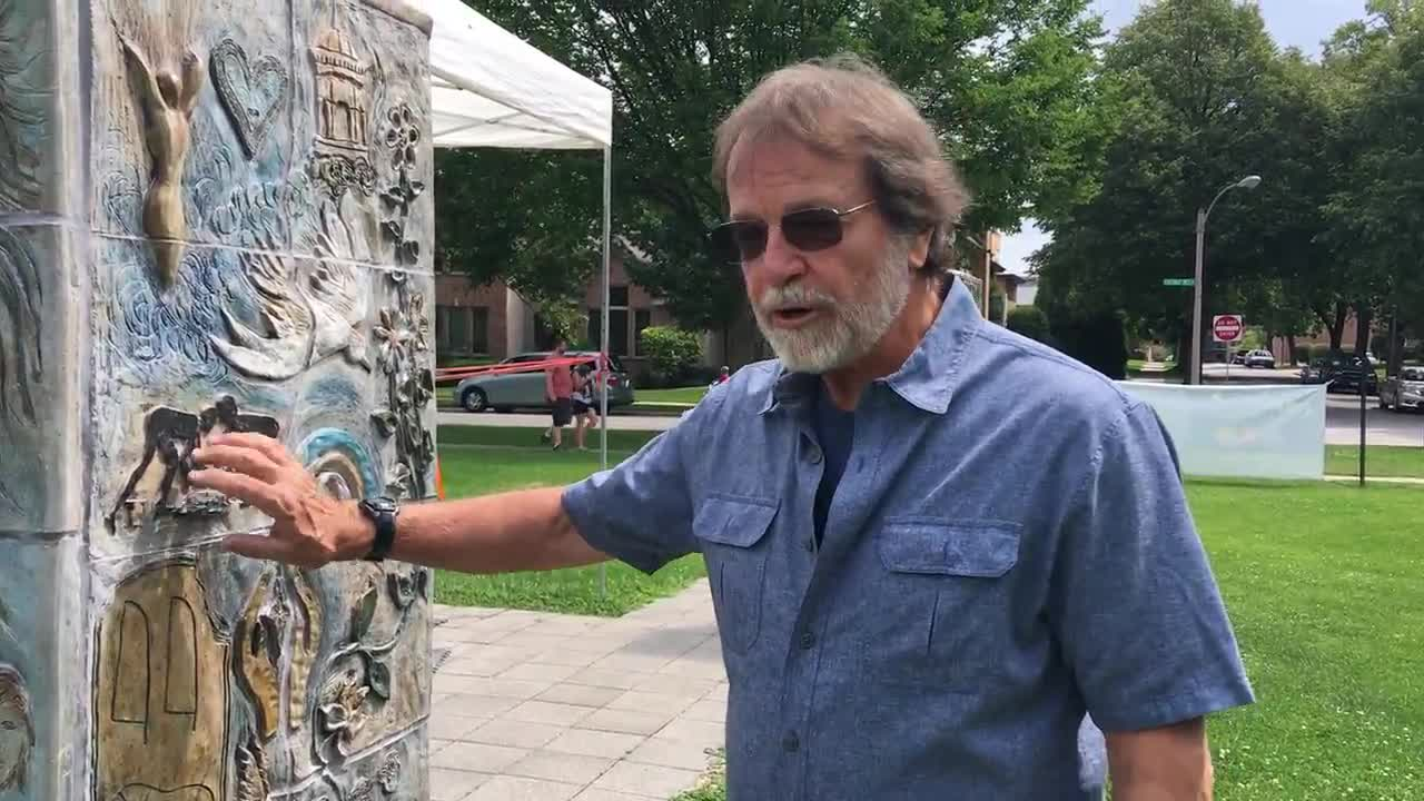 "Artist and educator John Nester describes the contribution the late John Carroll made to the 1997 ""Art from the Heart"" mural pillars project at the Elmhurst Art Museum. Nester and Brian McGlade are restoring the pillars this month."