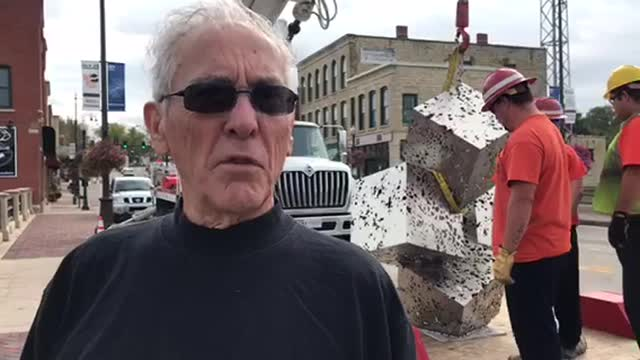 Artist Bruce White describes his piece, Fractal Cluster, as it's installed on the Wilson Street Bridge in downtown Batavia