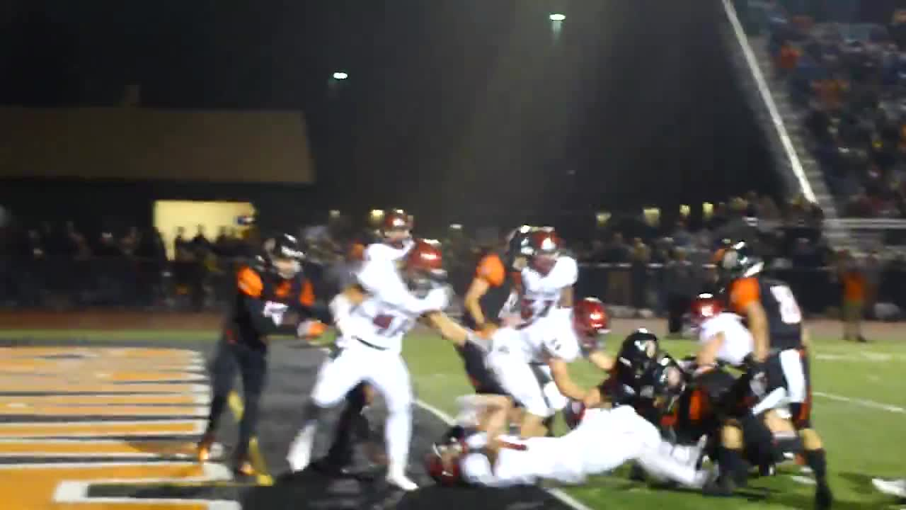 Lincoln-Way Central's Mike Morgan scores the go-ahead touchdown in his team's 27-17 victory.