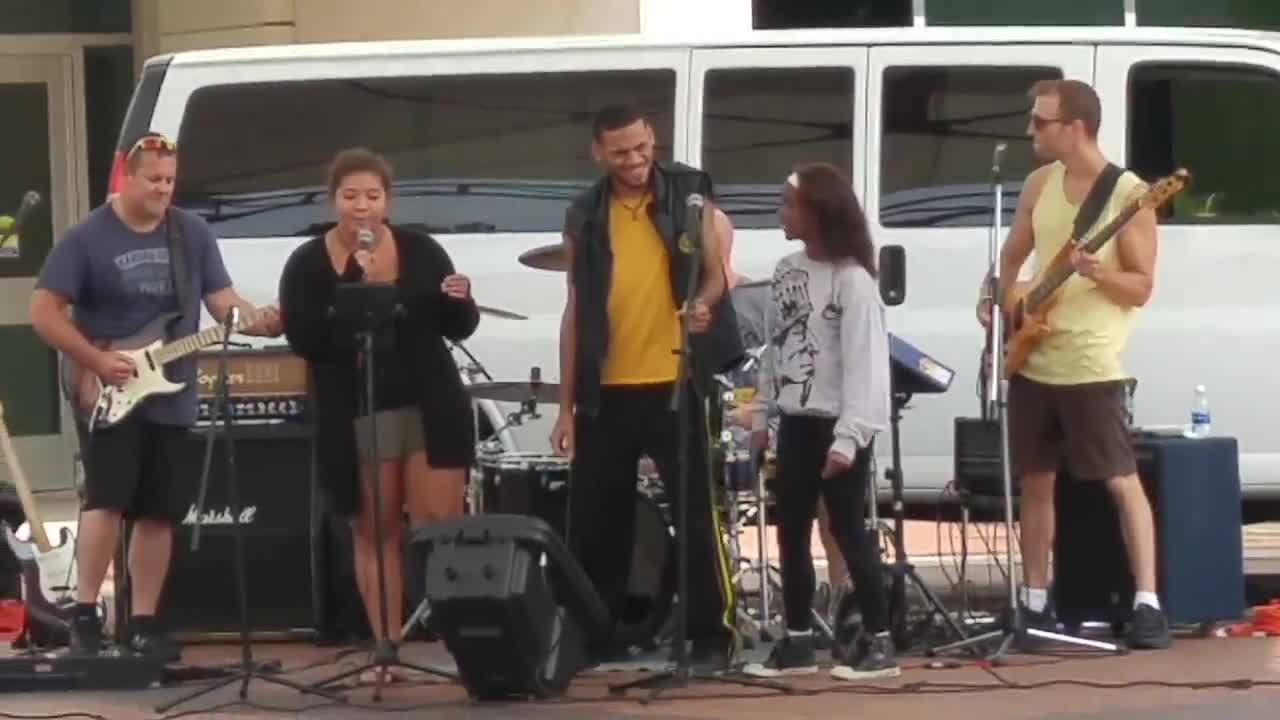 College of DuPage students participate in live band karoke on Aug. 31 at the Lakeside Pavilion as part of the college's Chaparral Days.
