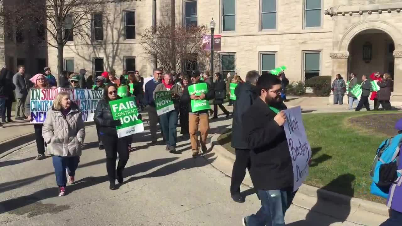 NIU employees and supporters gathered in front of Altgeld Hall on Monday, Nov. 20, 2017, to rally for wage increases.