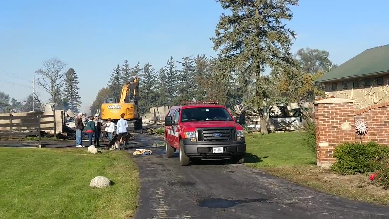 Indoor horse arena is destroyed near residential homes.